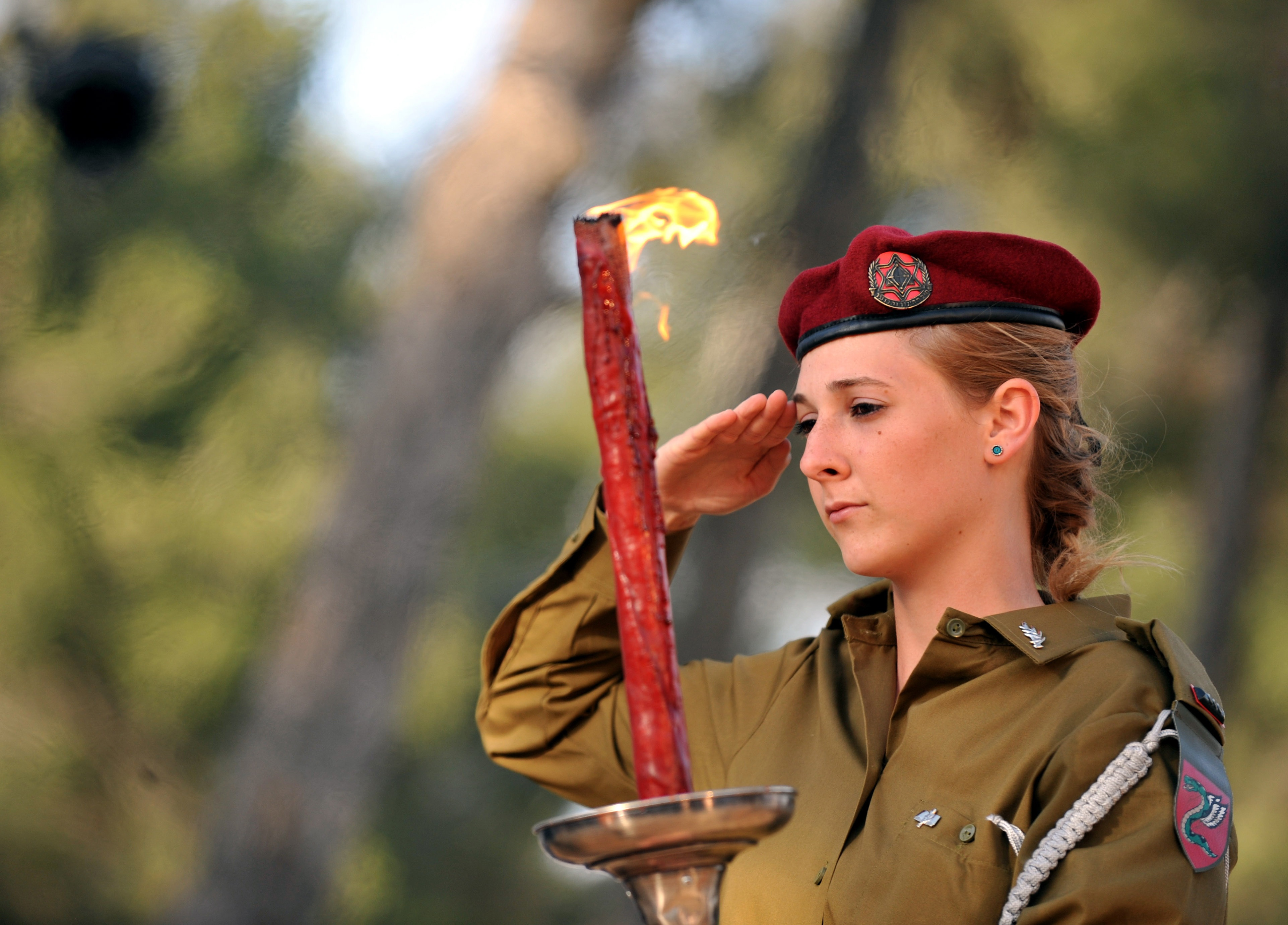 Yin Bogu - Pool/Getty Images. An Israeli soldier lights a torch during the Jerusalem Day ceremony at Ammunition hill May 21, 2009 in Jerusalem, Israel. Israeli Prime Minister Benjamin Netanyahu stated that all of Jerusalem will remain Israel's capital amidst protests at the Damascus gate of the Old City of Jerusalem wall by eastern Jerusalem Arabs and their supporters.