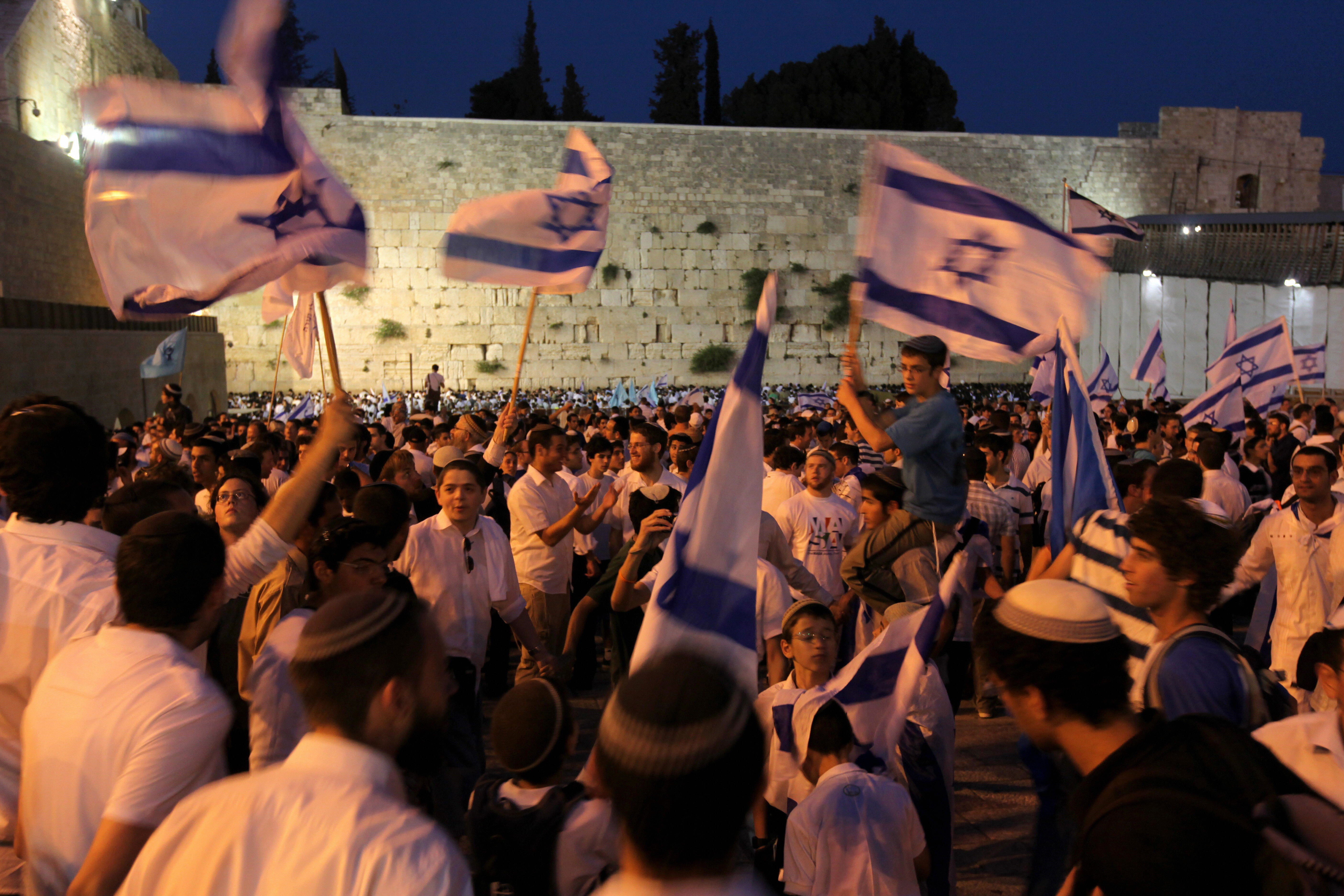 MENAHEM KAHANA/AFP/Getty Images. Young Israelis dance with national flags in hand at the Western Wall, Judaism's holiest site, in Jerusalem's Old City during celebrations on May 21, 2009 of Jerusalem Day which marks the anniversary of the reunification of the holy city. Right-wing Prime Minister Benjamin Netanyahu vowed that Jerusalem would remain Israel's capital 'forever' as the Jewish state marked the 42nd anniversary of the occupation and annexation of Arab east Jerusalem in the 1967 six day Arab-Israeli war.