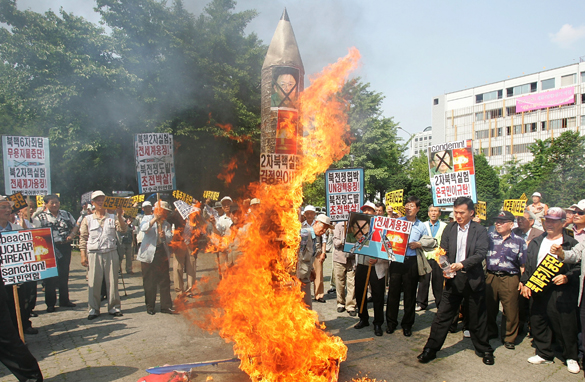 South Koreans burn a mockup of a North Korean missile during a rally on May 25, 2009 in Seoul, South Korea. Getty Images