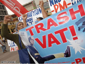 Protestors in Manilla show anti-VAT signs in 2006.  A value-added tax may be gaining traction with lawmakers in the U.S.