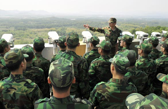 South Korean soldiers look at the North Korean side as they visit an observation post in Paju near the Demilitarised Zone (DMZ) dividing the two Koreas on May 27, 2009. Getty Images