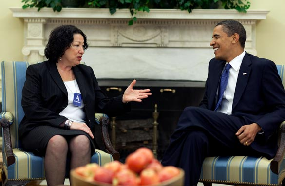 In this handout image provided by the White House, Judge Sonia Sotomayor speaks with President Obama in the Oval Office of the White House May 21, 2009 in Washington, D.C.