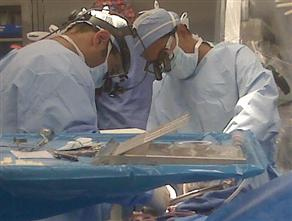 Dr. Sanjay Gupta (right) at work in the O.R.