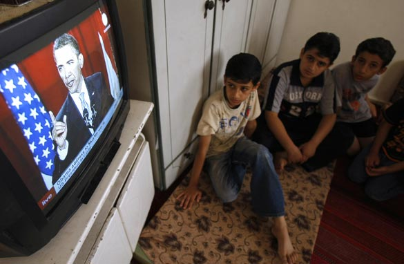 Palestinian boys listen to President Barack Obama as he delivers a speech at Cairo University, at their home in the southern Gaza Strip town of Rafah on June 4, 2009. Getty Images
