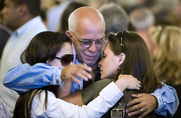 Friends and relatives of the Air France flight 447 passengers comfort each other after attending a mass in their homage at the Candelaria Cathedral on June 4, 2009 in Rio de Janeiro, Brazil. Getty Images