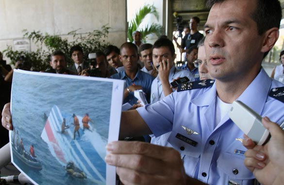Brazilian Air Force officer Henry Nunhoz shows a picture during a press conference to announce the recovery of more bodies of the 228 victims of the of the Air France A330 aircraft lost in midflight over the Atlantic ocean June 1st, in Recife, Brazil on June 8, 2009. Getty Images