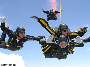 President George H. W. Bush enjoys a good birthday skydive.
