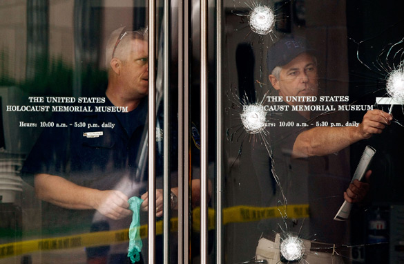 Investigators from the Federal Bureau of Investigation examine a bullet ridden door at the entrance to the Holocaust Memorial Museum June 11, 2009 in Washington, DC. Getty Images