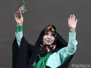 Zahra Rahnavard, wife of Iranian presidential candidate Mir Hossein Mousavi, waves to supporters during a pro-reform campaign rally at Haydarniya Stadium in Tehran on June 9, 2009.