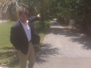 David Mattingly stands at the end of the driveway to Gov. Sanford&#039;s beach house.