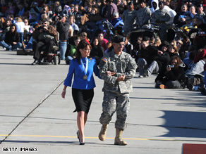 Palin (here visiting son Tracks Army brigade) plans to visit members of the Alaska National Guard.