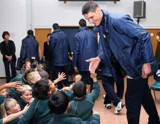 Hannah Johnston/Getty Images. 7ft 6' Syrian player Abd Al Wahab Al Hamowi greets school pupils as the Syrian U19 basketball team as they visit Willow Bank School on June 29, 2009 in Auckland, New Zealand. The Syrian team are in New Zealand for the 2009 FIBA U19 World Champiosnhip.