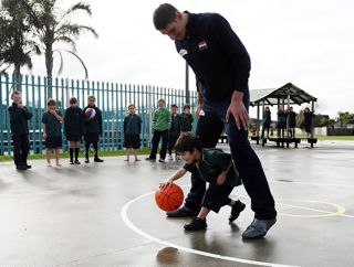 Hannah Johnston/Getty Images. Five-year-old Boston Thompson dribbles the basketball through the legs of 7ft 6' Syrian player Abd Al Wahab Al Hamowi as the Syrian U19 basketball team visit Willow Bank School on June 29, 2009 in Auckland, New Zealand. The Syrian team are in New Zealand for the 2009 FIBA U19 World Championship.