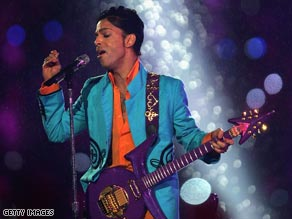 Prince performs at the halftime show of the 2007 Superbowl.