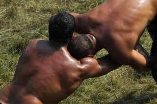 MUSTAFA OZER/AFP/Getty Images. Turkish oil wrestlers fight during the 648th historical Kirkpinar oilwrestling tournament held every year in Sarayici, near Edirne, on July 5, 2009.