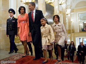 Sasha Obama wandered into President Obama's bed early Tuesday morning to have a chat with her parents.