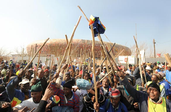 Workers strike in front of the unfinished Soccer City stadium in Soweto.