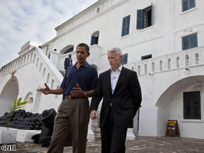 CNN's Anderson Cooper and President Obama walking around Cape Coast Castle.