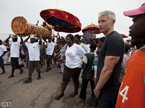 Anderson Cooper joins a parade to celebrate the appointment of a new Chief on the Cape Coast of Ghana.