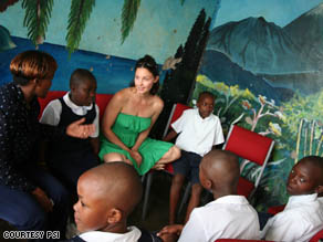 Ashley Judd visiting families in her role as YouthAIDS Global Ambassador.