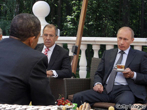 President Barack Obama (L) and Russian Prime Minister Vladimir Putin (2R) converse while having traditional Russian tea on a terrace at Putin&#039;s residence outside Moscow on July 7, 2009.