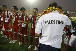 AHMAD AL-RUBAYE/AFP/Getty Images. Members of the Palestinian team stand on the pitch at the start of the friendly match Iraq versus Palestine at the al-Shaab Stadium in central Baghdad on July 13, 2009. Iraq won 4-0.