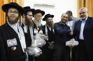 MOHAMMED ABED/AFP/Getty Images. Hamas leader Ismail Haniya (R) gives gifts to members the anti-Zionist religious Jewish communities of the USA Naturei Karta during their visit to Gaza City on July 16, 2009.