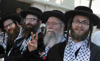 MAHMUD HAMS/AFP/Getty Images. US members of the anti-Zionist religious Jewish community Naturei Karta attend a ceremony at the Palestinian parliament in Gaza City during their visit to the Hamas-run territory July 16, 2009.