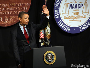 President Barack Obama walks onto stage to speak at the NAACP annual convention July 16, 2009 in New York City.