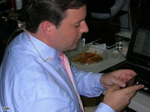 CNN's Ed Henry on his iPhone tweeting from Cleveland as he reports on President Obama.