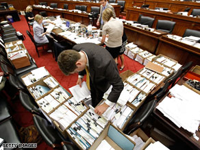 Boxes of amendments sit in the chamber where the House Energy and Committee meets.