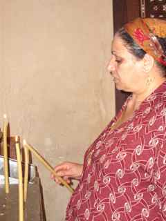 Rym Momtaz/CNN. A Coptic woman lights a candle inside the Hanging Church in Coptic Cairo. Millions of Copts live in Cairo today