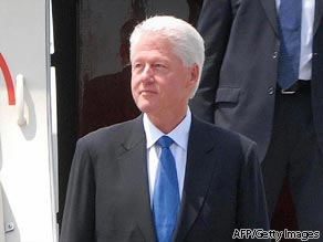 This photo taken on August 4, 2009 and released by North Korea's official Korean Central News Agency shows former US president Bill Clinton arriving at Pyongyang airport.