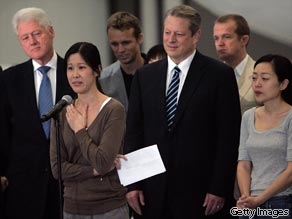 Journalists Laura Ling speaks in front of Euna Lee, former Vice President Al Gore and former President Bill Clinton on August 5, 2009 in Burbank, California after being released by North Korean authorities.