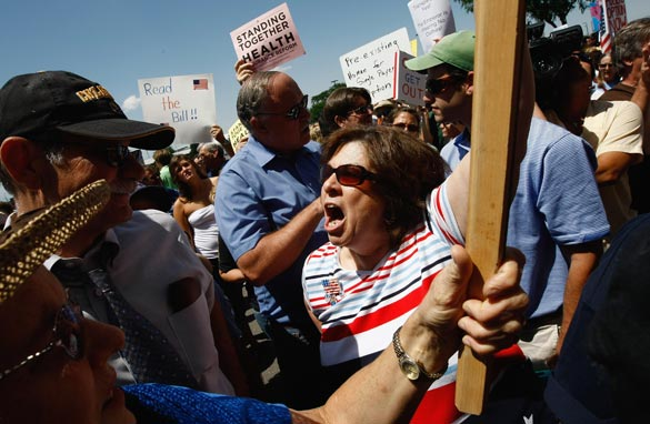 Several hundred people, both for and against health care reform, gathered to demonstrate on August 8, 2009 in Brighton, Colorado. (Photo by John Moore/Getty Images)