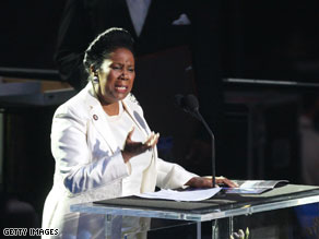  Rep. Sheila Jackson Lee, D-Texas, was caught on camera talking on a cell phone during a town hall meeting on Tuesday.