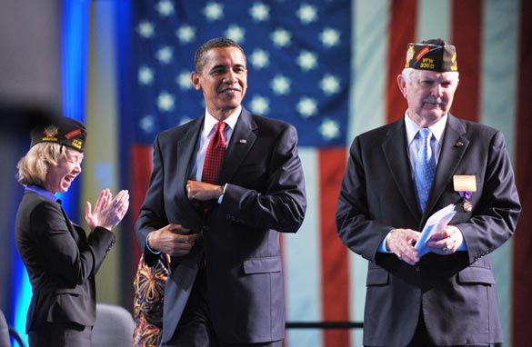 President Barack Obama arrives on stage with Veterans of Foreign Wars (VFW) Commander-in-Chief Glen Gardner (R) to address the annual Veterans of Foreign Wars National Convention August 17, 2009 in Phoenix, Arizona. (MANDEL NGAN/AFP/Getty Images)
