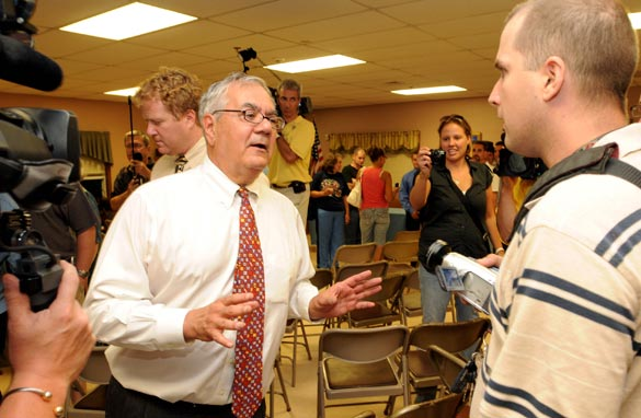 Rep. Barney Frank (D-MA) (L) argues with a man following a town hall meeting August 18, 2009 at the Dartmouth Council on Aging in Dartmouth, Massachusetts. (Photo by Darren McCollester/Getty Images)