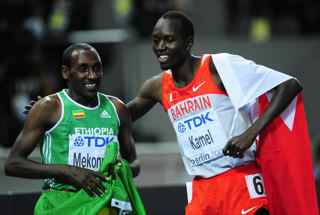 FRANCK FIFE/AFP/Getty Images. Bahrain's Yusuf Saad Kamel (R) and Ethiopia's Deresse Mekonnen celebrate after the men's 1500m final race of the 2009 IAAF Athletics World Championships in Berlin.