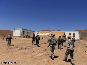 U.S. soldiers from the 1st Platoon Alpha 3-71 Cavalry and Afghan National Army (ANA) soldiers walk up a hill to a school during a mission in the Baraki Barak district of Logar Province, Afghanistan on August 22.