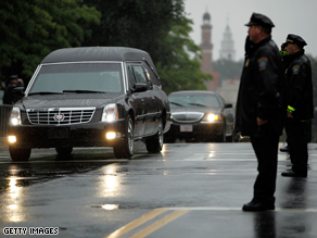 Crowds lined the street as the motorcade carrying the body of Sen. Ted Kennedy passed by.