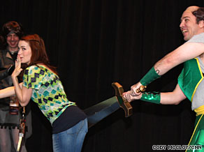 Felicia Day, creator/star of web series 'The Guild,' re-enacts a scene from the show's music video with a costumed fan.