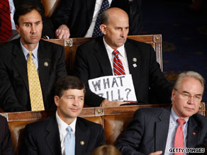 One Republican member of Congress holds up a sign during President Obama&#039;s speech to Congress Wednesday night