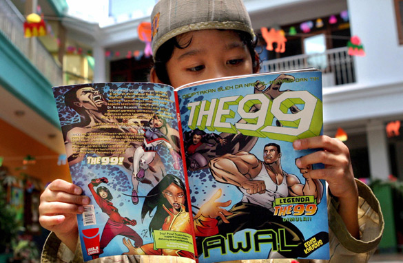 A young boy reads a copy of the 'The 99' comic book at his school in Jakarta. (PHOTO: AFP/GETTY IMAGES)