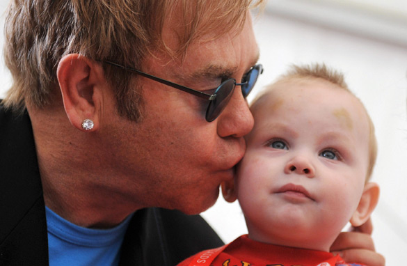 Elton John meets 14-month-old Lev at an orphanage for HIV/AIDS-affected children in Ukraine. (PHOTO: AFP/GETTY IMAGES)