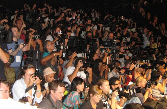 Photojournalists at the Diane von Furstenberg show.