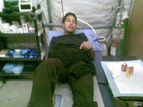 Dr. Sanjay Gupta, who contracted H1N1 in Afghanistan, receives treatment.