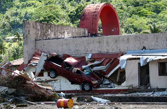 This photo taken on September 29, 2009 after an 8.0-magnitude quake and tsunami struck in the early morning offshore shows a damaged building and truck in Pago Pago, on American Samoa. (JOHN NEWTON/AFP/Getty Images)