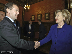 Russian President Dmitry Medvedev shakes hands with Secretary of State Hillary Clinton outside Moscow.