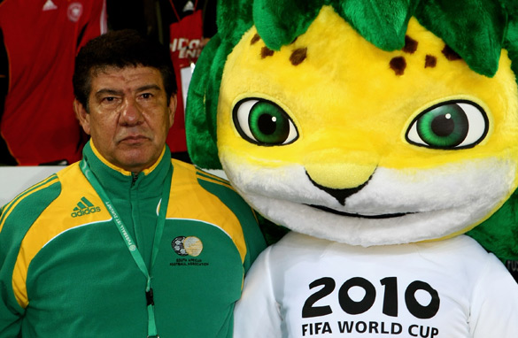 A glum-looking Santana contemplates his World Cup fate with mascot Zakumi